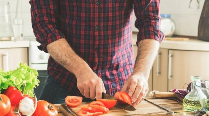 man preparing healthy meal